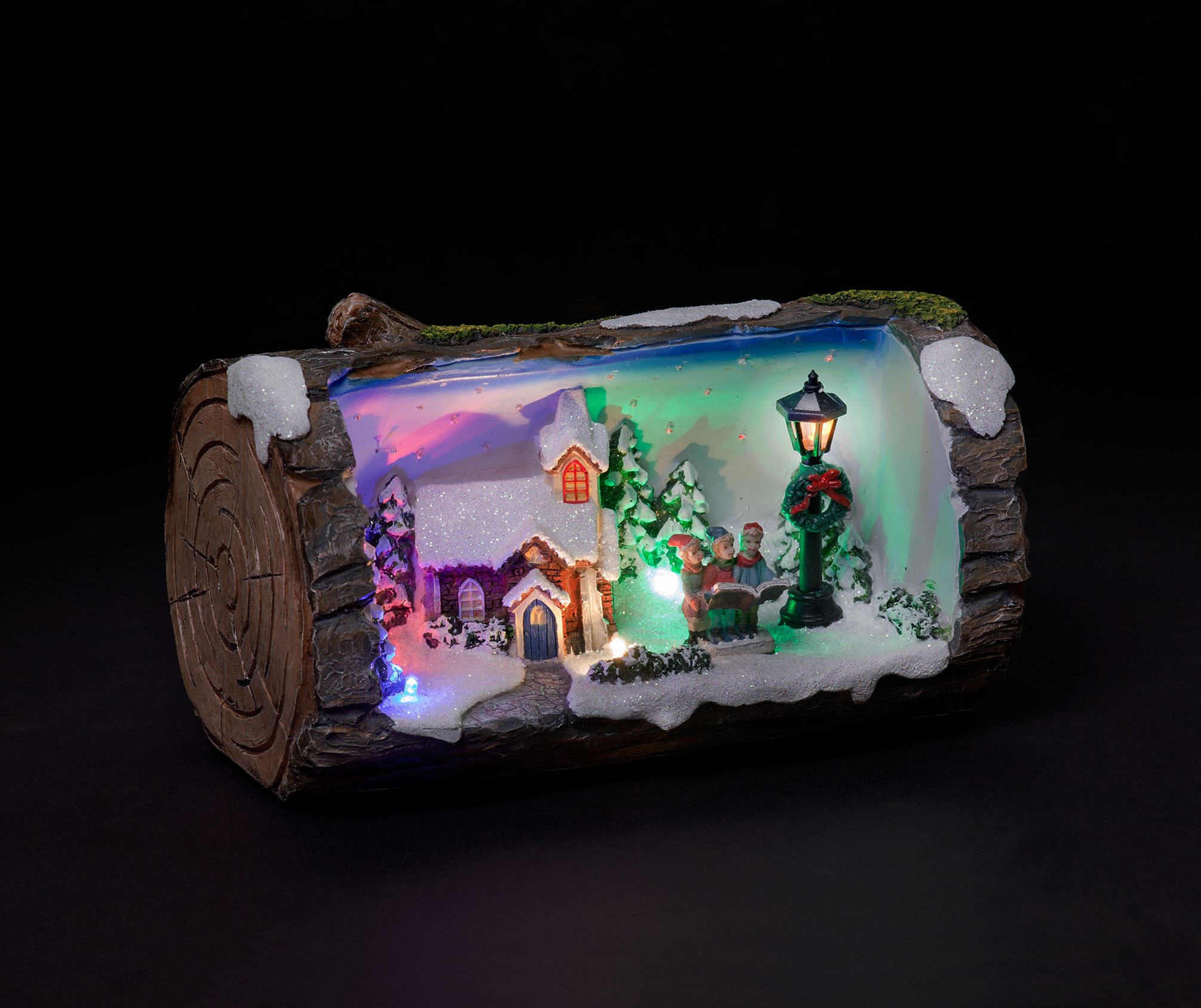 Click to view product details and reviews for Carol Singers Illuminated Animated Christmas Log.