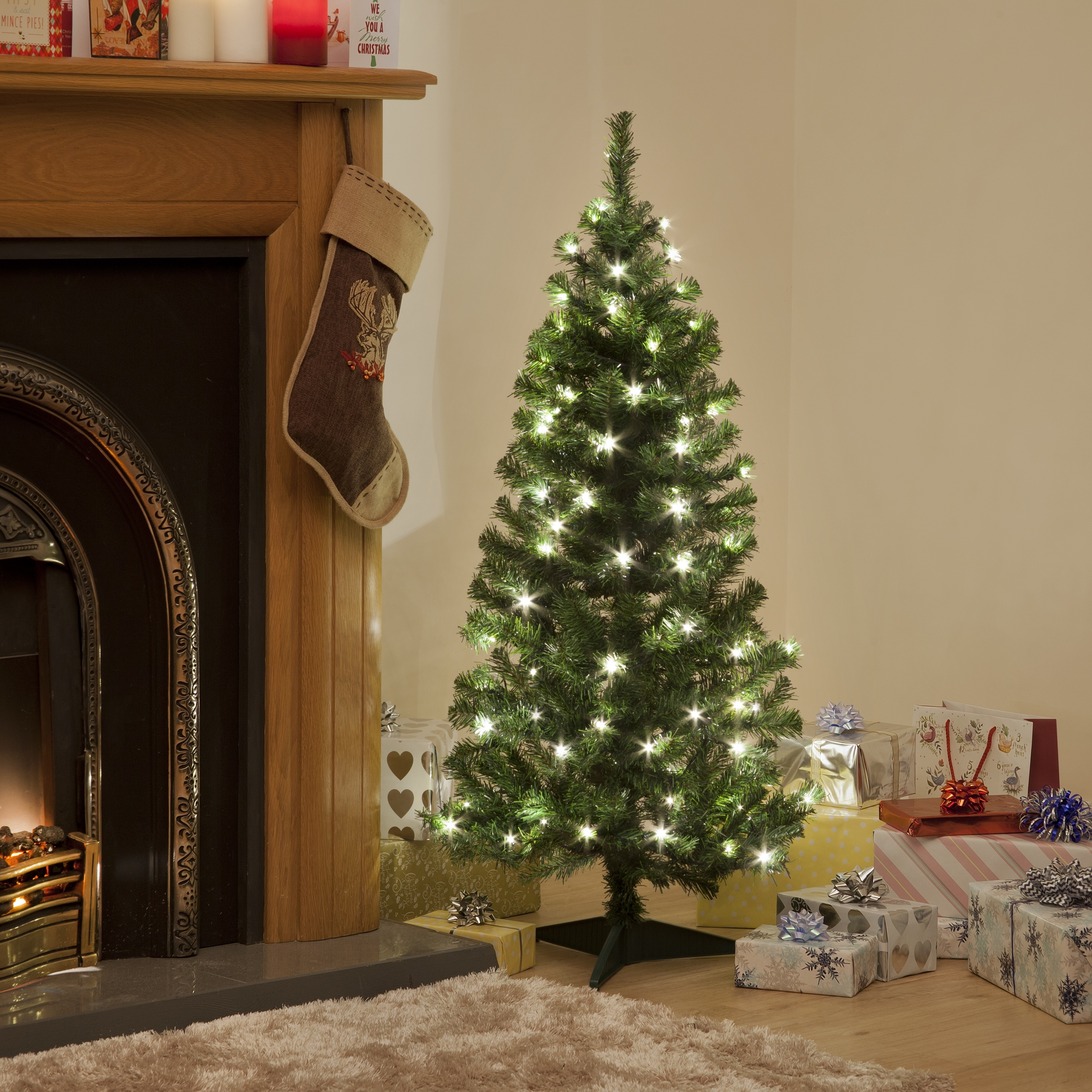 Click to view product details and reviews for 120cm Pre Lit Deluxe Green Tree With 100 Warm White Leds.