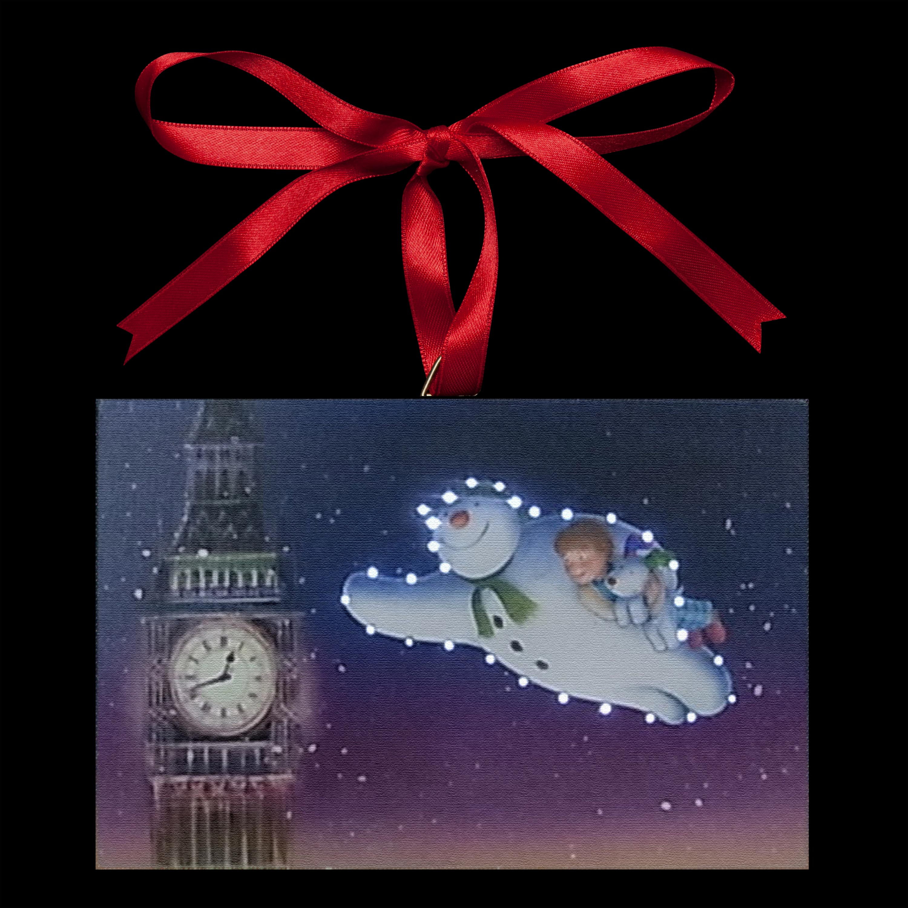 Click to view product details and reviews for The Snowman Flying Around Big Ben Illuminated Canvas.