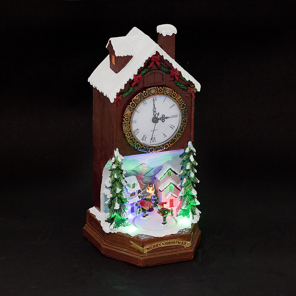 Battery Operated 31cm LED Clock House with Turning Skaters